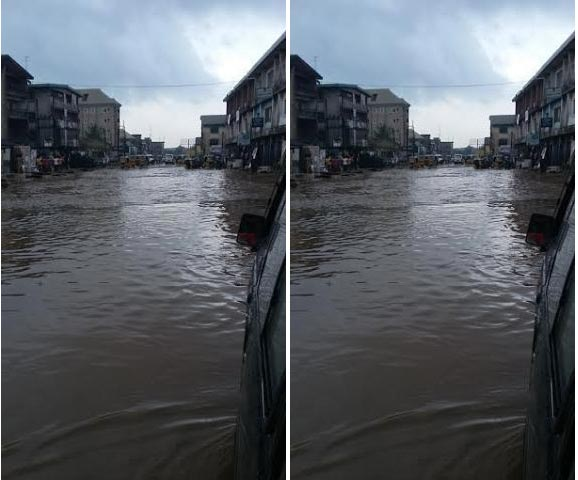 See the state of major road leading to Ariara Intl Market in Aba