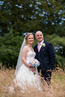 Bride and groom in the grounds of Tickton Grange hotel on their wedding day