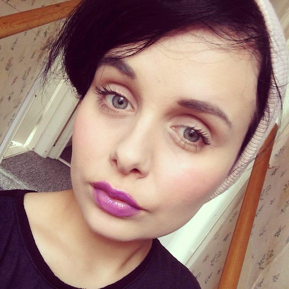 purple lipgloss illamasqua