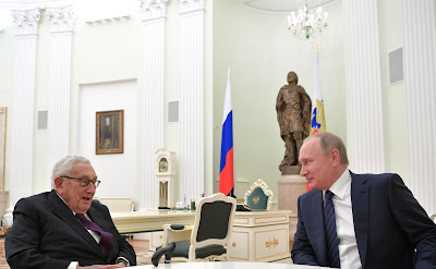 Vladimir Putin with former US secretary of state Henry Kissinger.