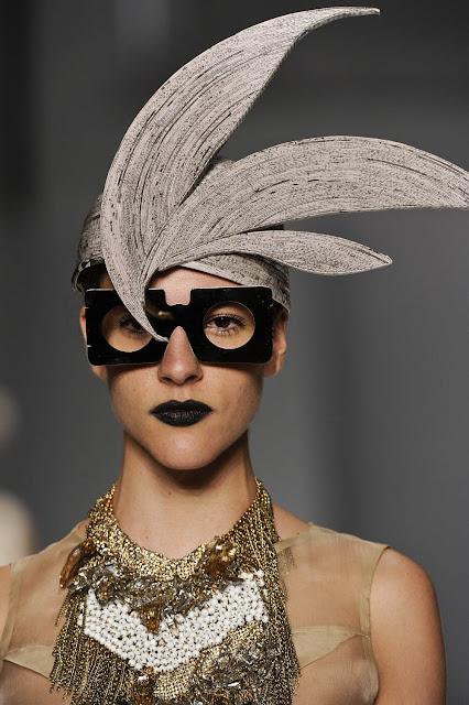 featherlike newspaper hat on model
