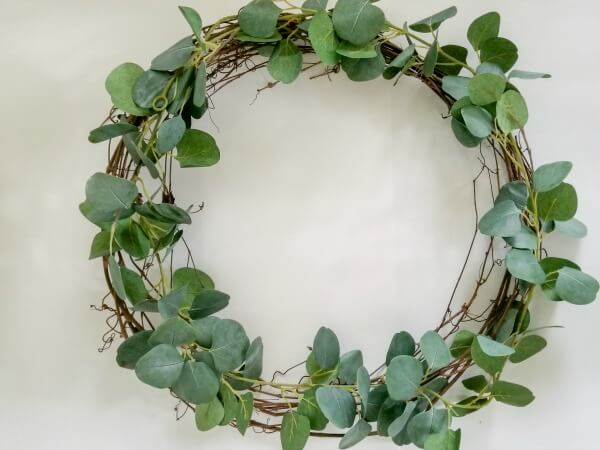 adding garland to wreath base