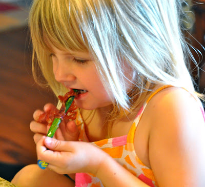 prosciutto wrapped around asparagus enjoyed by little girl