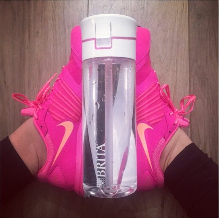 gym trainers and water bottle