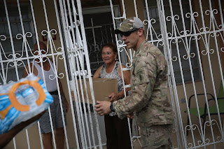 The Army helped distribute food and water in Puerto Rico in the wake of Hurricane Maria. (Credit: Joe Raedle/Getty Images) Click to Enlarge.