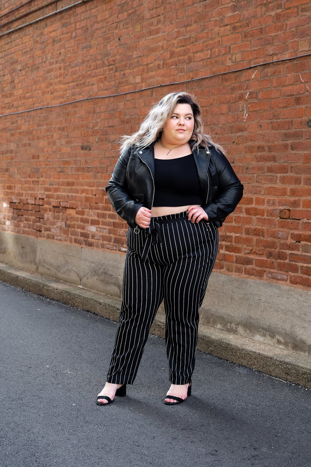 Chicago Plus Size Petite Fashion Blogger, YouTuber, and model Natalie Craig, of Natalie in the City, reviews Fashion Nova's paper bag waist pants and cropped tops.