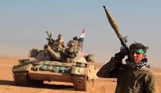 قوات الحشد الشعبي المقدس تعلن السيطرة على مركز تدريب داعش شرق تلعفر