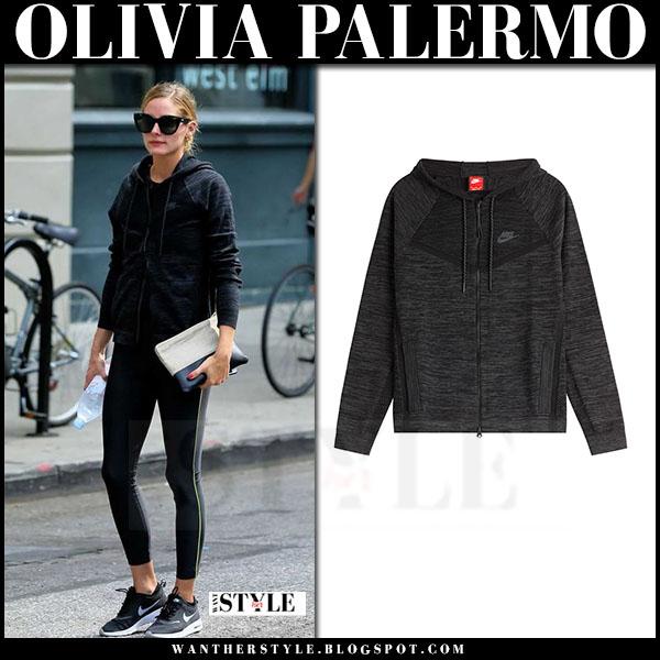 Olivia Palermo in dark grey nike hoodie, black leggings and black sneakers nike free rn what she wore