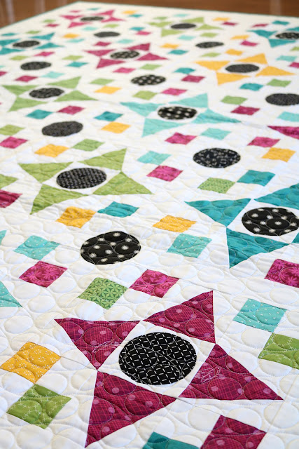 Game Night quilt pattern found in the Fresh Fat Quarter Quilts book by Andy Knowlton of A Bright Corner - a bold, bright, modern quilt with applique circles