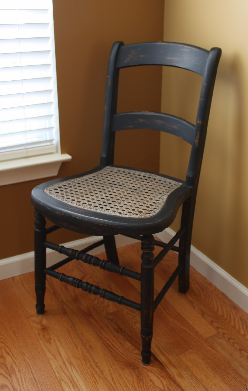 Chair painted black with dark wax.