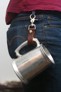 A steampunk leather tankard holster. To hold your beer tankard (beer mug) for hands free LARP and cosplay. Attaches to belt.