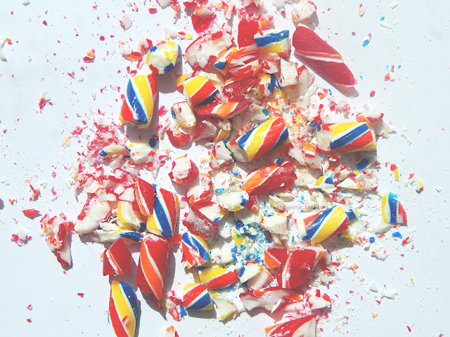 bright colorful candy smashed on a white background