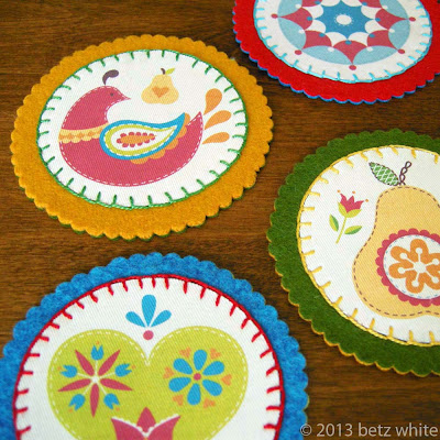 http://blog.betzwhite.com/2013/11/felt-and-fabric-coaster-tutorial.html