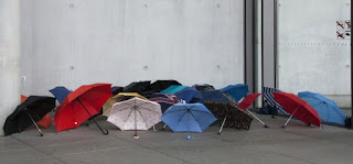 Some-Strange-Superstitions-That-Will-Make-You-Smile-Fingers-Crossed-image-of-open-umbrellas-on-the-ground