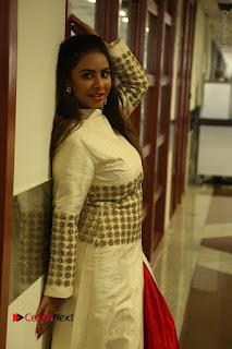 Telugu Actress Sri Reddy Mallidi Stills in White Beautiful Dress at Marriage Needs Bridal Fashion Week 2017 Logo Launch  0016.JPG