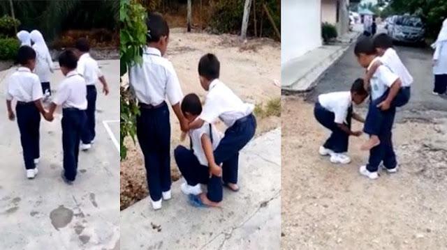 Fakta Media: [Video] Terharu, Adakah Sahabat seperti ini? Melihat Teman Sulit Berjalan 2 Sahabat ini Membantu sampe Menggendongnya Pulang