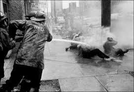 """Democrat """"Bull"""" Connor orders firemen to use their hoses on demonstrators."""