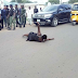 Woman lays on a busy road to  over 13 months unpaid salary - FOX NAIJA NEWS