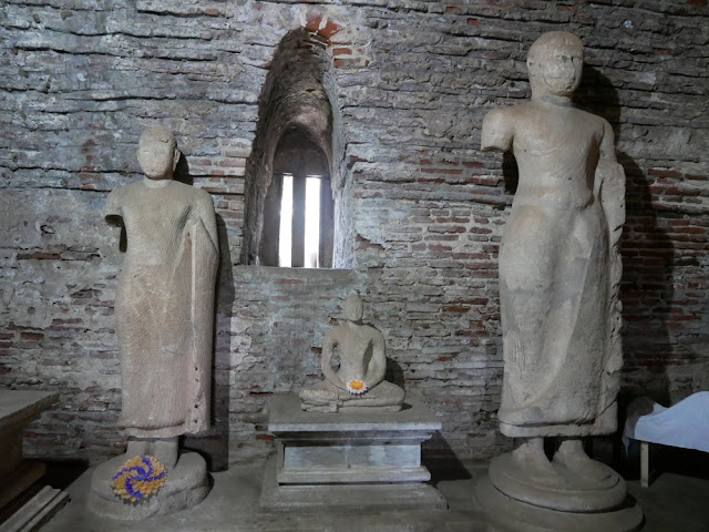 Broken Buddha statues in Sri Lanka