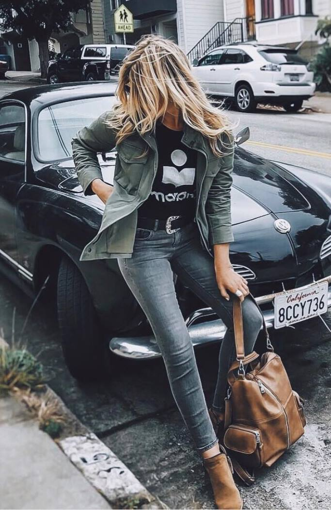casual fall outfit idea / skinny jeans + boots + brown bag + jacket + black printed top