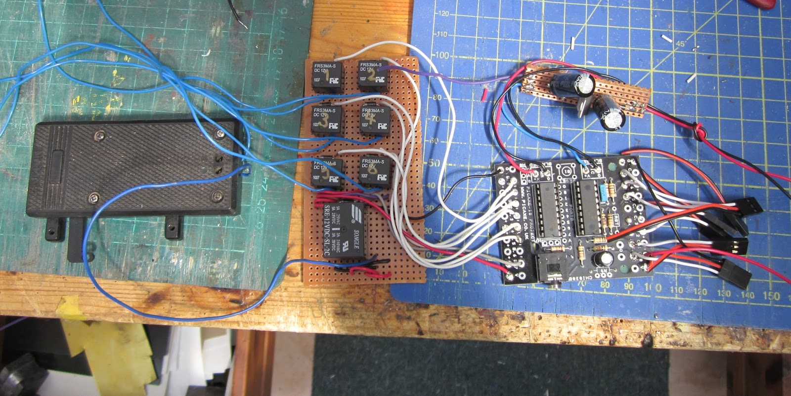 The Picaxe was then loaded with the full program and tested, before the  assembly was connected to the wiring for the point motors and placed in the  control ...
