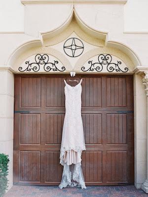 wedding dress hanging from gate