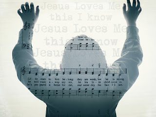 person in praise,  hands raised, music superimposed