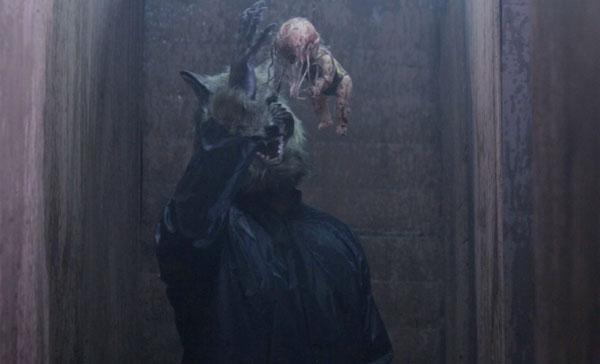 The wolf-masked antagonist in THE FARM: EN VEETTU THOTTATHIL (2017)