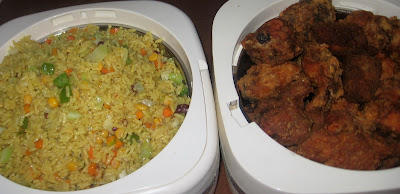 Nigerian fried rice served in food warmers