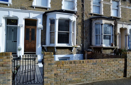 Victorian black and white mosaic brick wall yellow red rail wrought metal Yorkstone caps and entrance stone London Balham Clapham Battersea Putney