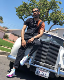 Phyno Flaunts His White Rolls Royce (Photos)