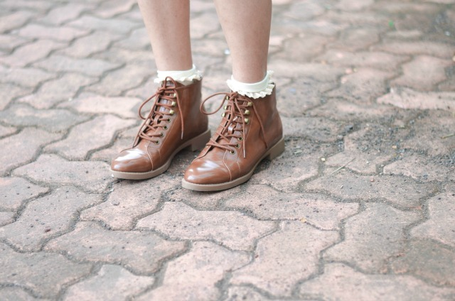 Brown patent leather lace up boots