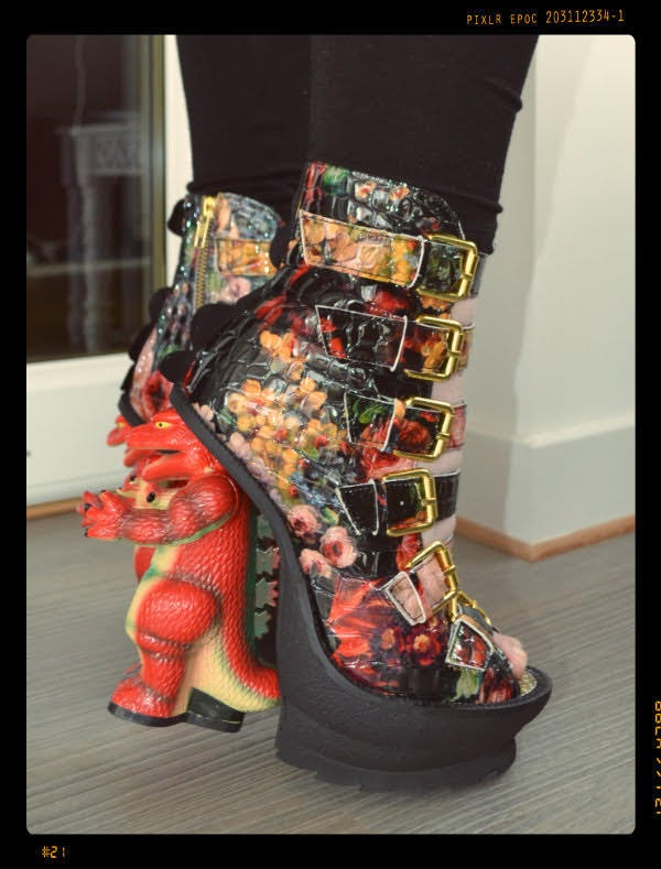 dinosaur heeled character heel shoes with floral uppers on foot