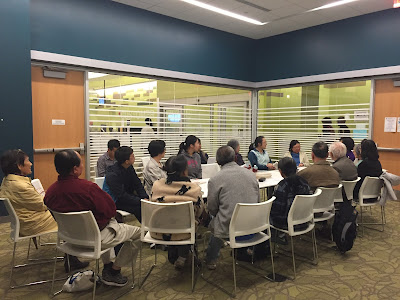 Participants at table discuss Daughter's Taiwan, Father's China by Chen Hao