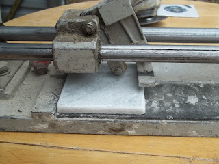 Tile Cutter Ready to Cut Piece of Ceramic Tile