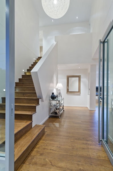 Photo of hallway and staircase interiors inside of contemporary home in Brisbane
