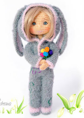 Amigurumi doll, girl with bunny suit and flowers