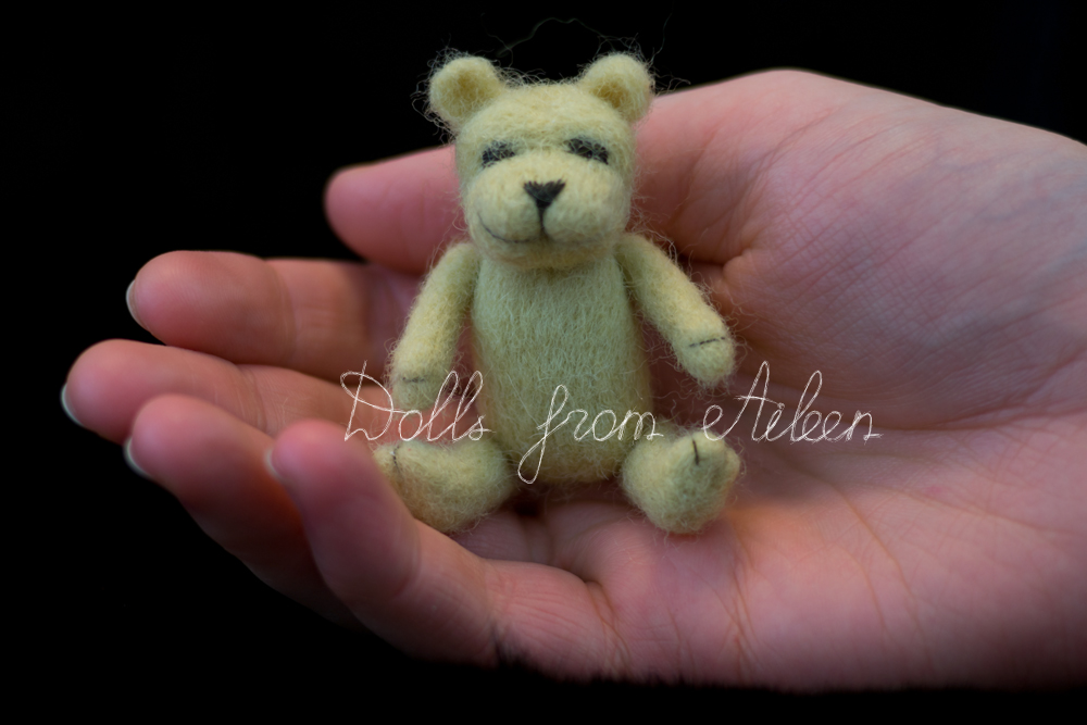 OOAK mini needle felted teddy bear in human hand