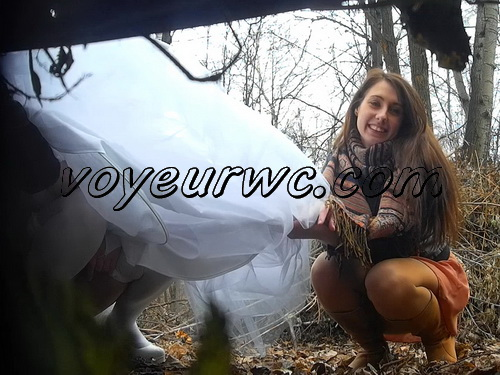 A bride in her wedding dress pissing outdoors with a spy cam observing (Wedding Pissing Park 14)