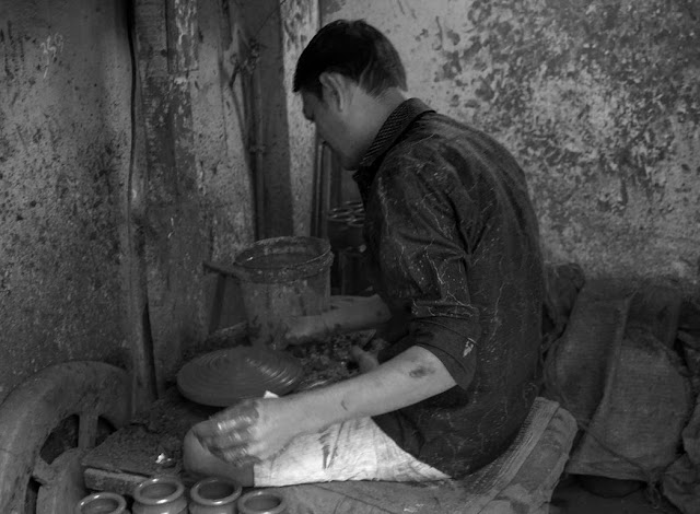 monochrome potter wheel kumbharwada dharavi mumbai india