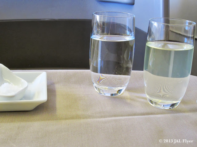 "JAL First Class trip report on JL005 - JAL Original Drink ""SKY TIME SHIKWÂSÂ CITRUS"""