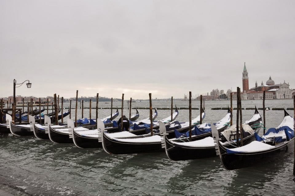 Gondolas covered with snow in Venice
