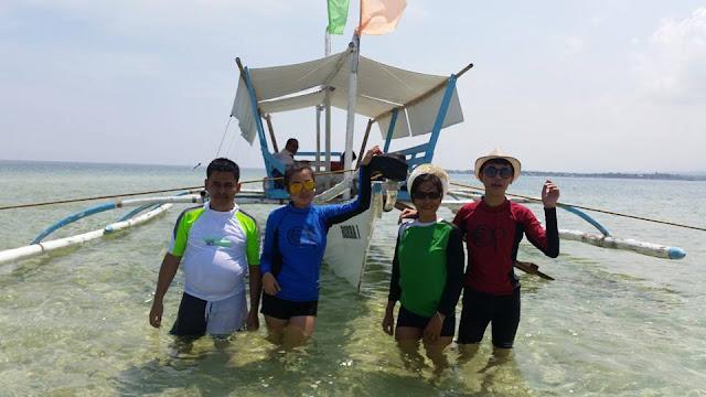 With boat we rented to Campalabo sandbar