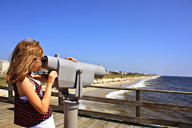 Taking a peek through a scope on the pier at Kure Beach in North Carolina