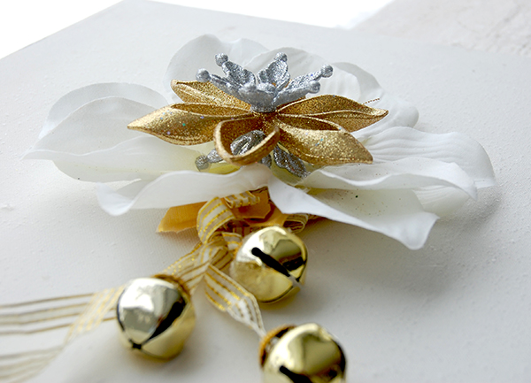 white and gold ornaments, white flower, gold bell door hanger upclose