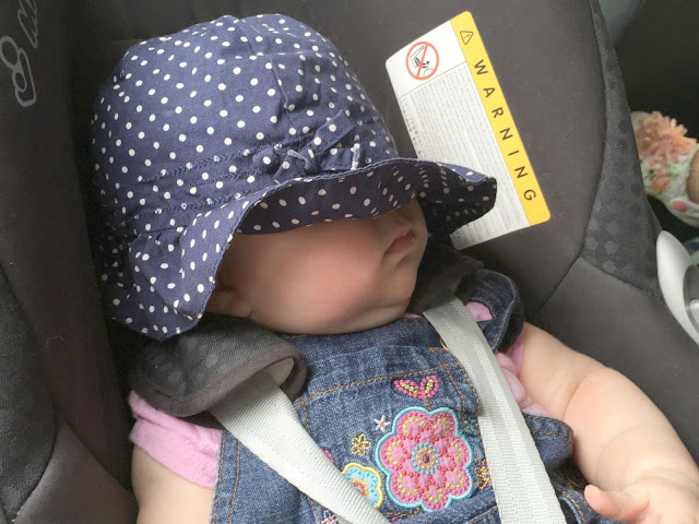 Tin Box Baby sat in her car seat with a hat over her eyes