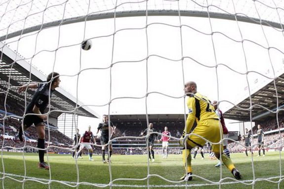 Liverpool's Steven Gerrard clears the ball off the line during a match against Aston Villa