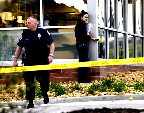 Metro Nashville Police work the scene where four people died after a gunman opened fire at a Waffle House in Antioch early Sunday, April 22, 2018.