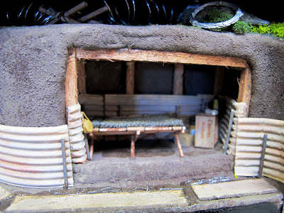 Miniature scene of an anderson shelter.