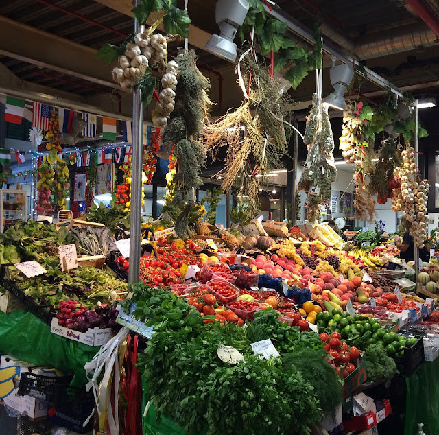 a colorful fresh vegetable stand